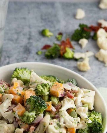 A bowl of creamy Broccoli and Cauliflower Salad