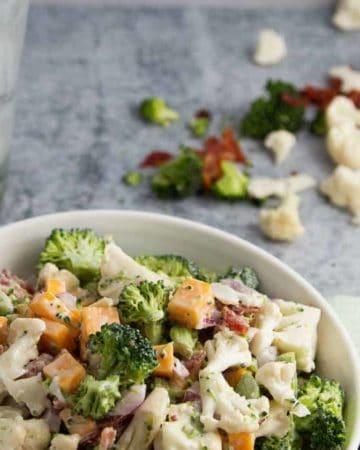 A bowl of creamy Broccoli and Cauliflower Salad