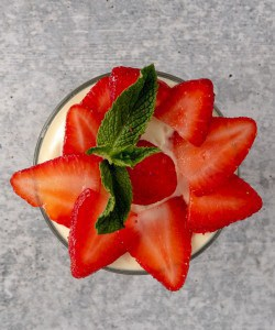 A bowl of beautifully garnished creamy strawberry pudding. Simply Delicious