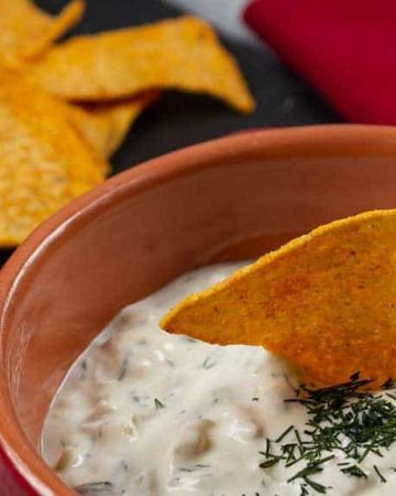 Dill Dip in a bowl served with gluten free sweet potato crackers