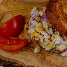 Super Simple Tuna Salad Sandwich recipe on served on a gluten free bagel.
