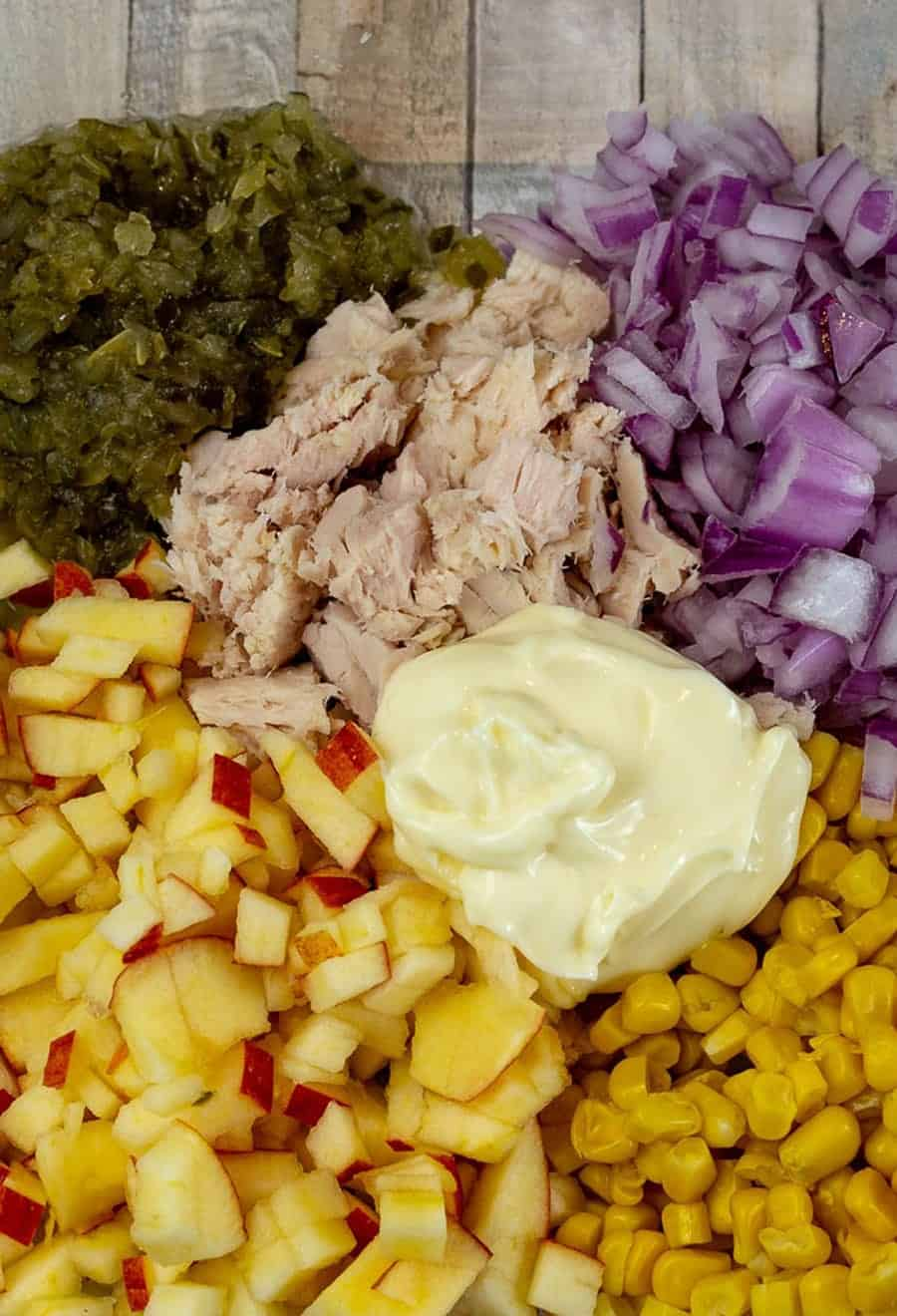 Tuna Salad Recipe that's only got 6 ingredients. Canned Tuna, sweet corn, s pickle relish, onion, apple, and mayo