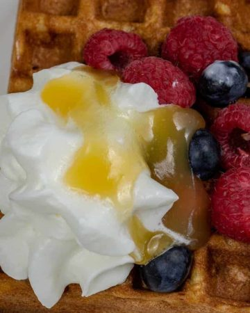 Gluten Free Waffles with Blueberries and Raspberries with Whipped Cream and Lemon Turd