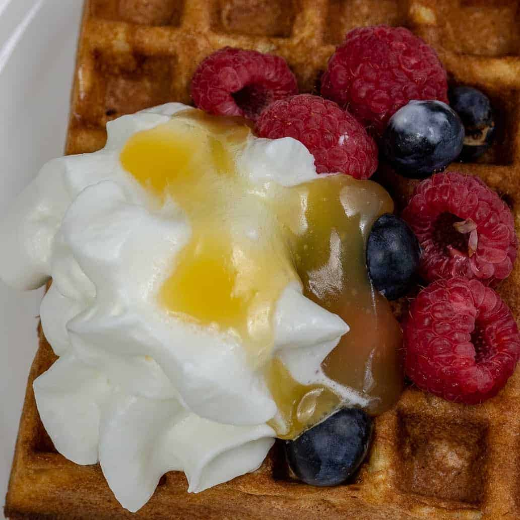 Gluten Free Waffles with Blueberries and Raspberries with Whipped Cream and Lemon Curd