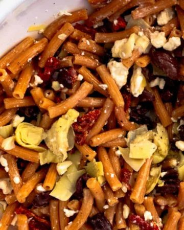 Learn how to make a gluten free lentil pasta salad in under 15 minutes. This delicious gluten free pasta salad is a perfect option for lunch or dinner.