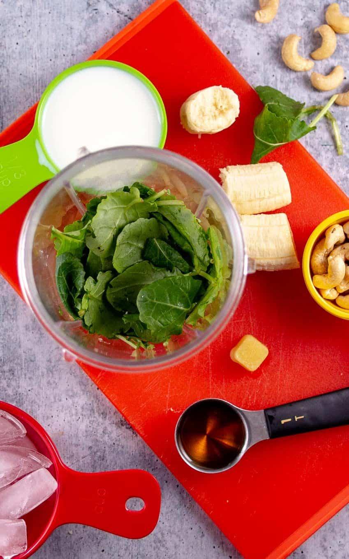 Kale Banana Smoothie Ingredients including: kale, banana, ginger, cashews, milk, and maple syrup (optional).