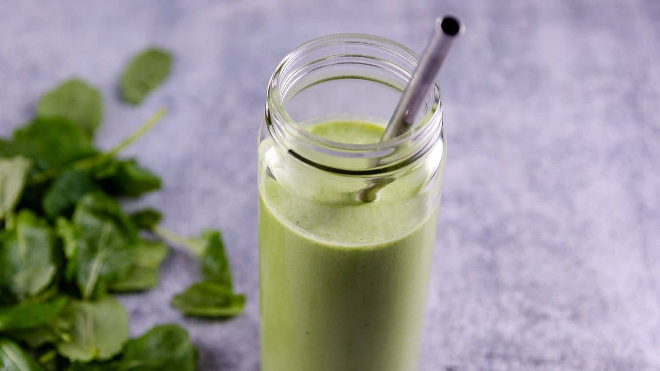 Kale Banana Smoothie served in a wide mouth smoothie glass
