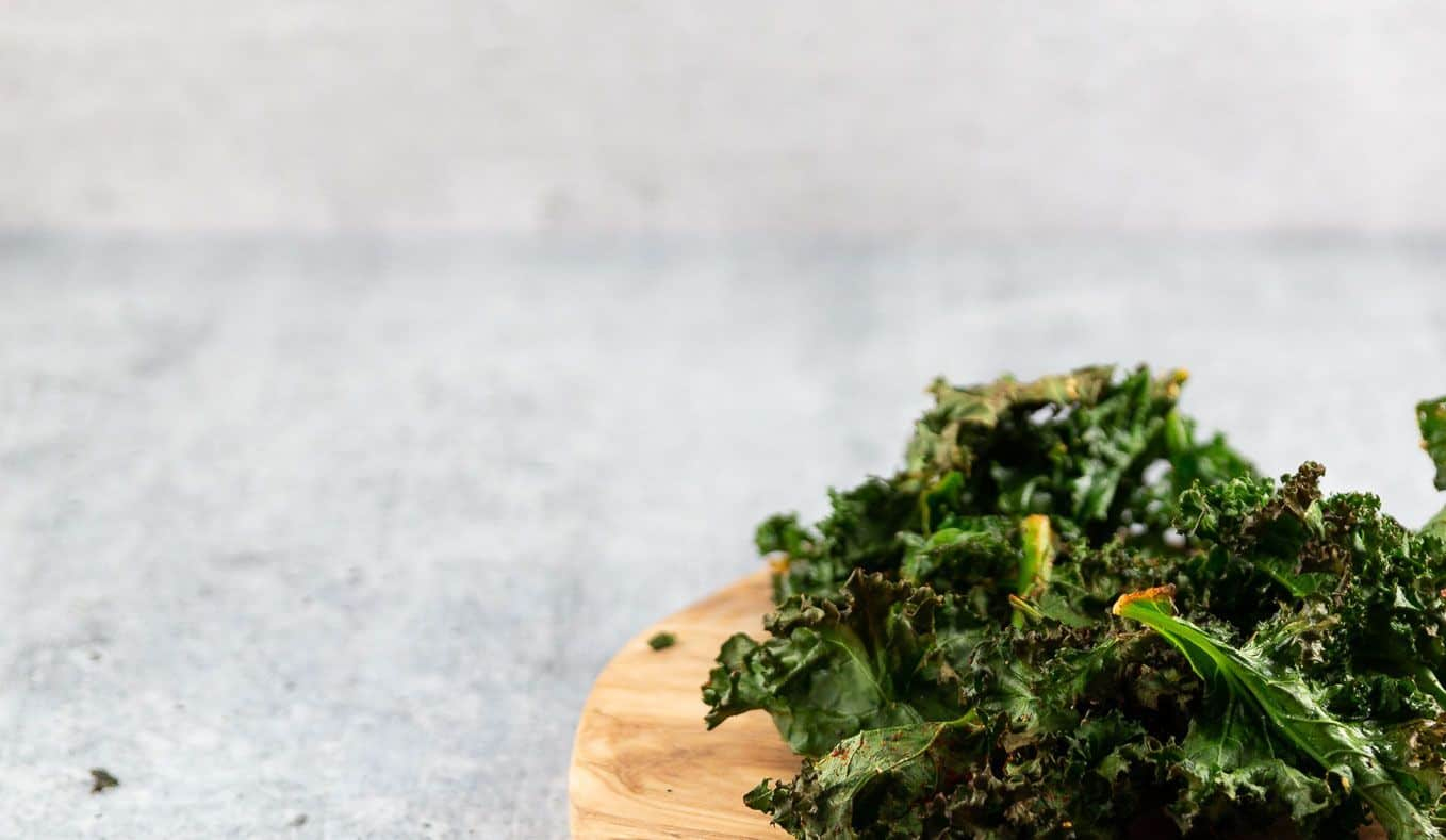 roasted kale on wooden plate ready for snacking