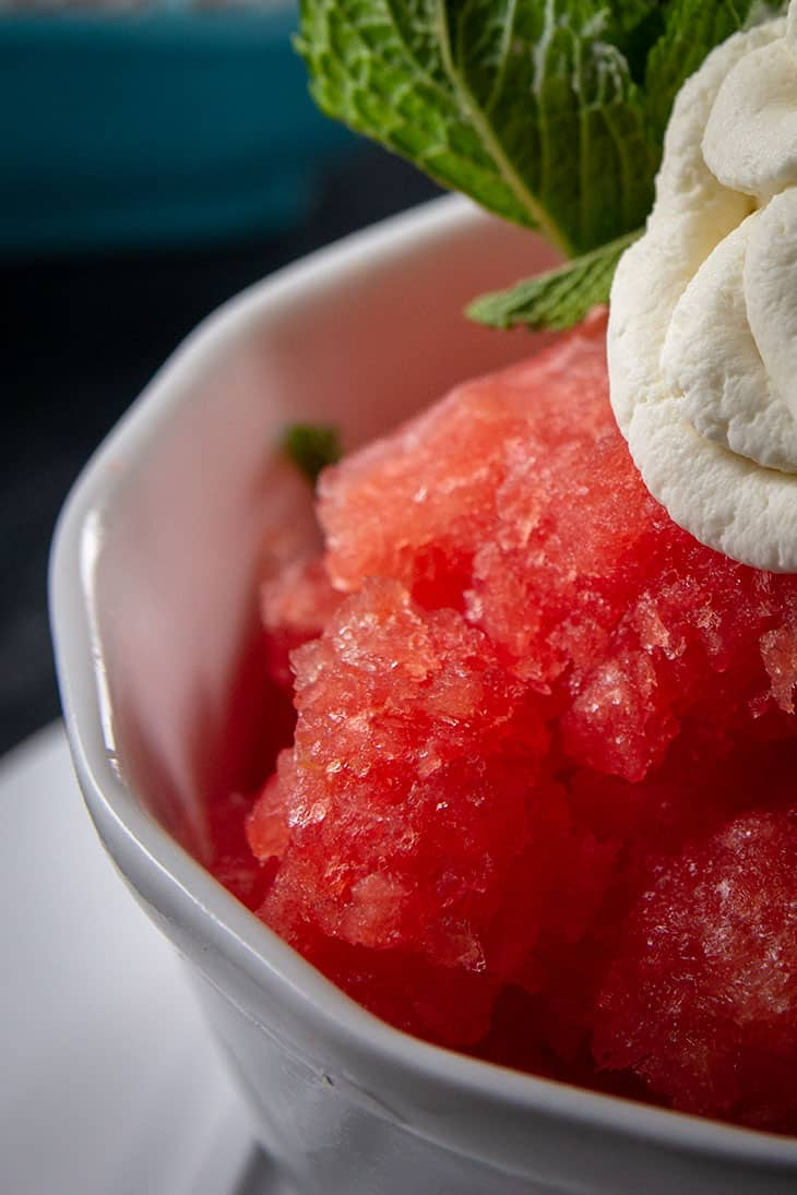 Frozen Watermelon Granita in a dessert jar topped with mint whipped cream